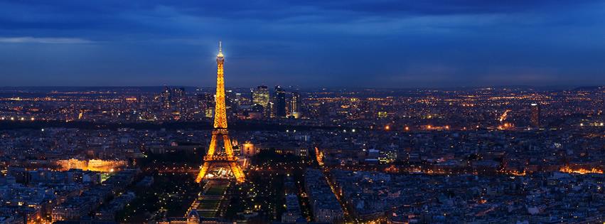 Capa para Facebook com foto panorâmica noturna de Paris mostrando a Torre Eiffel